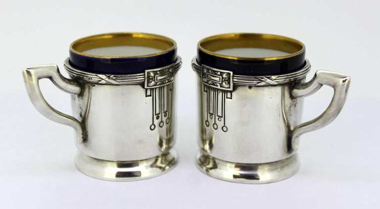 Antique Austrian Silver and Porcelain Enameled Cups circa 1867-1872 Maker: FR 800/1000 Fully hallmarked.  Dimensions -  Size: 7.5 x 5.1 x 5.5 cm Total weight: 197 grams Silver weight only: 120 grams  Condition: One of the silver cups has
