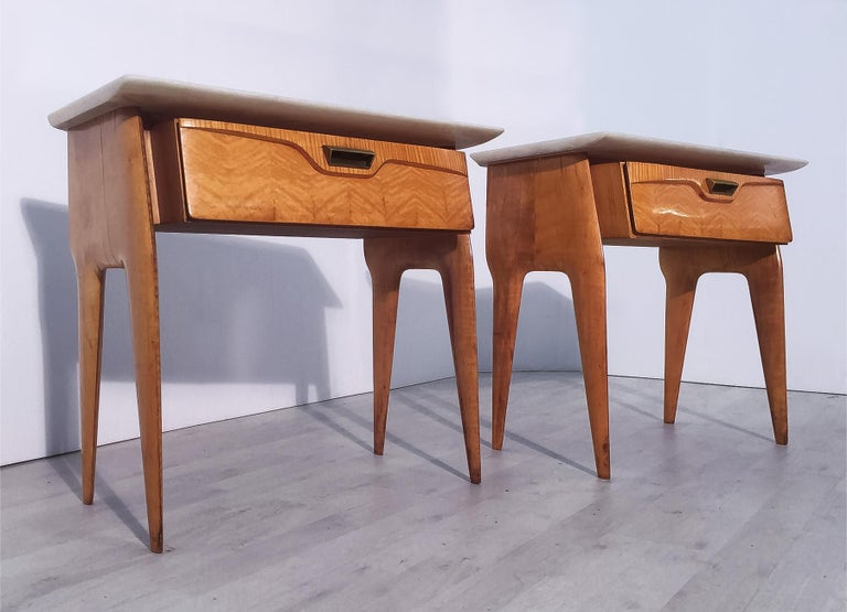 Pair of stylish Italian nightstands manufactured by La Permanente di Cantù in 1950s. Structures made in yellow maple veneer, equipped with drawers finished with brass handles and surmounted by white marble top. In good conditions of the period,