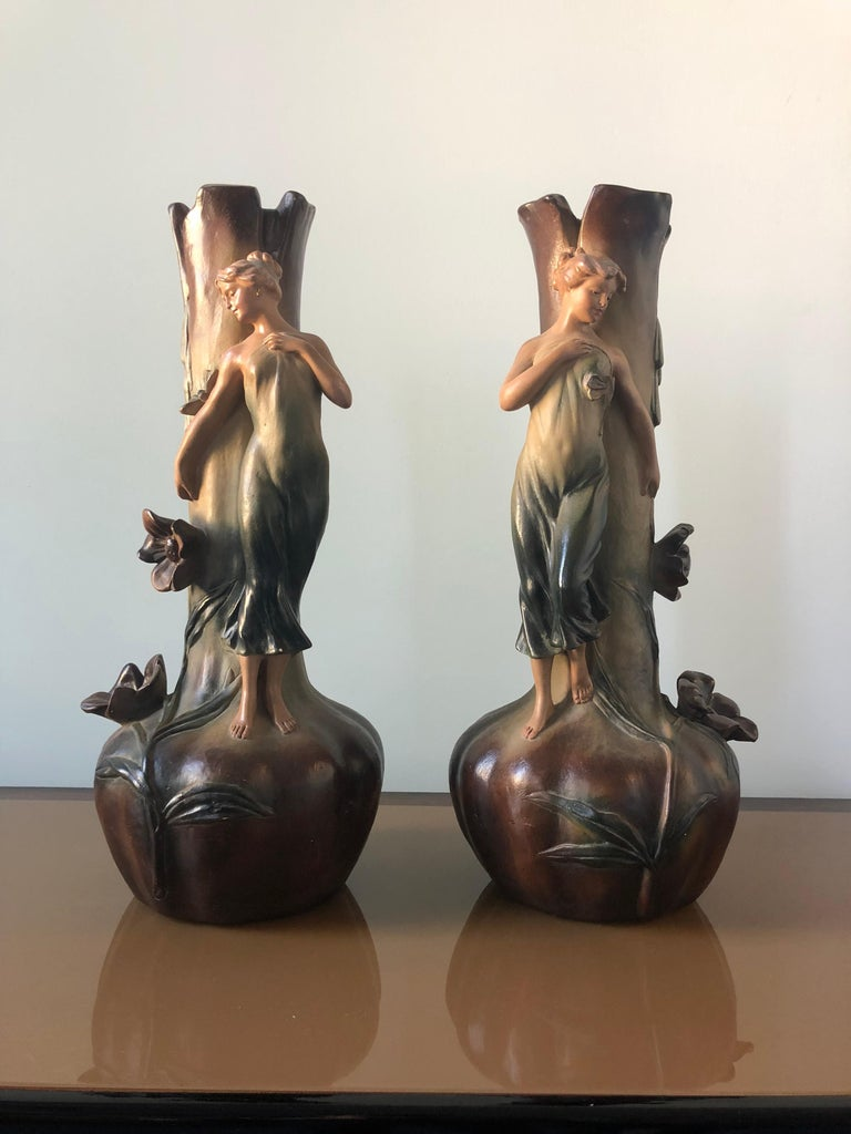 A stunning French Art Nouveau pair of large vases with female figures of the era, circa 1910.