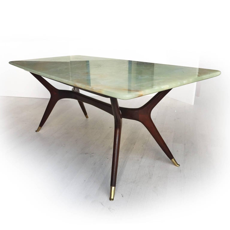 Stylish and rare lounge table attributed to Ico Parisi, with tabletop in light green Pakistan onyx, very rare marble chosen by the most important designers of the 1950s to increase the value of their furniture. In excellent conditions of the period,