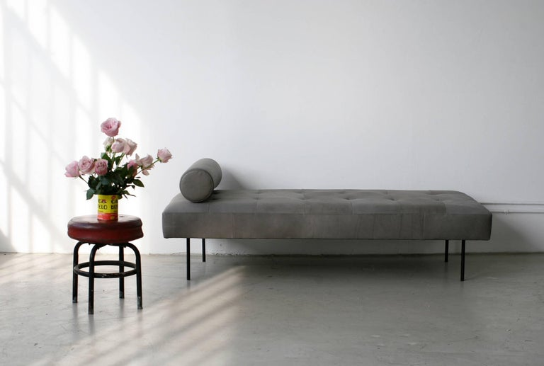 Smaller than a sofa, but bigger than a bench, the Goddard daybed functions as both when needed. It takes its form from 1950s French Industrial design, maintaining a sense of lightness and geometry. With a removable bolster and powder-coated steel