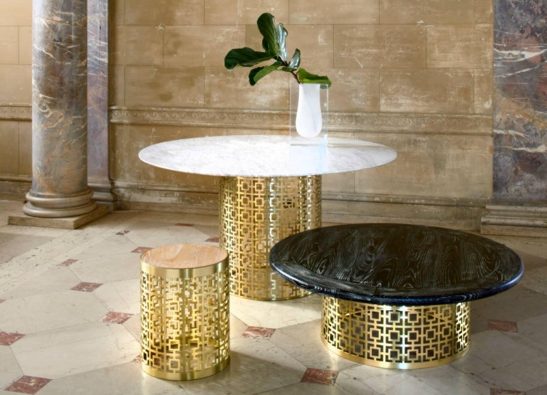 Graphic Glamour. Our signature Nixon pattern rendered in perforated brushed brass provides a sophisticated perch for a solid black marble tabletop. Contact Dealer for additional finish options.  Specs: Marble Top: 44 in. Dia x 1.75 in. H Base: 26