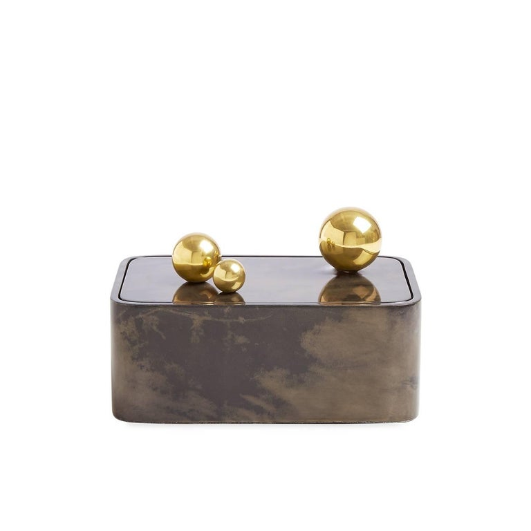 Lacquered goatskin meets polished brass spheres in our elementally simple Trocadero Box. Jonathan aimed to pare down basic shapes for a box that makes the most minimal gestures functional and dynamic. Generously sized and uncompromisingly glamorous,