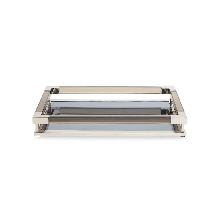Clearly cool. A petite version of our popular Jacques Tray, this size is perfect for a vanity, console, cocktail table, or even the kitchen counter. Corral your prized possessions without crowding your space. Available in moody smoke with polished