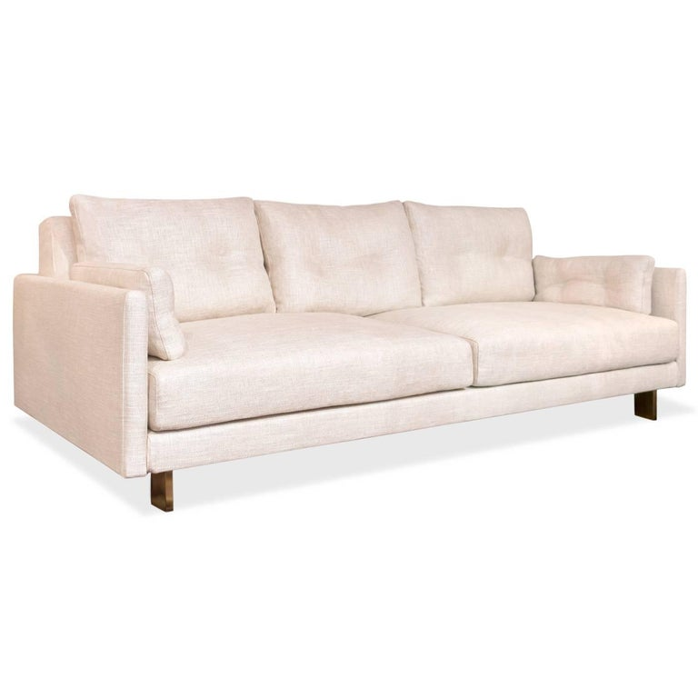 California Modern. Deep and squishy, family-friendly, and très chic you can have it all. Upholstered in Mulholland Pearl bouclé with minimal brushed brass legs. Combine details like inviting pin-tucked back and side cushions, with removable,