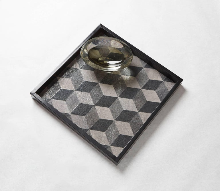 With an emphasis on textural and geometric elements, the Shagreen Geo tray is a masterpiece of symmetry and monochrome. Perfectly sized cubes in various gradients of gray appear to extend from the tray's surface with an Escher-esque quality of