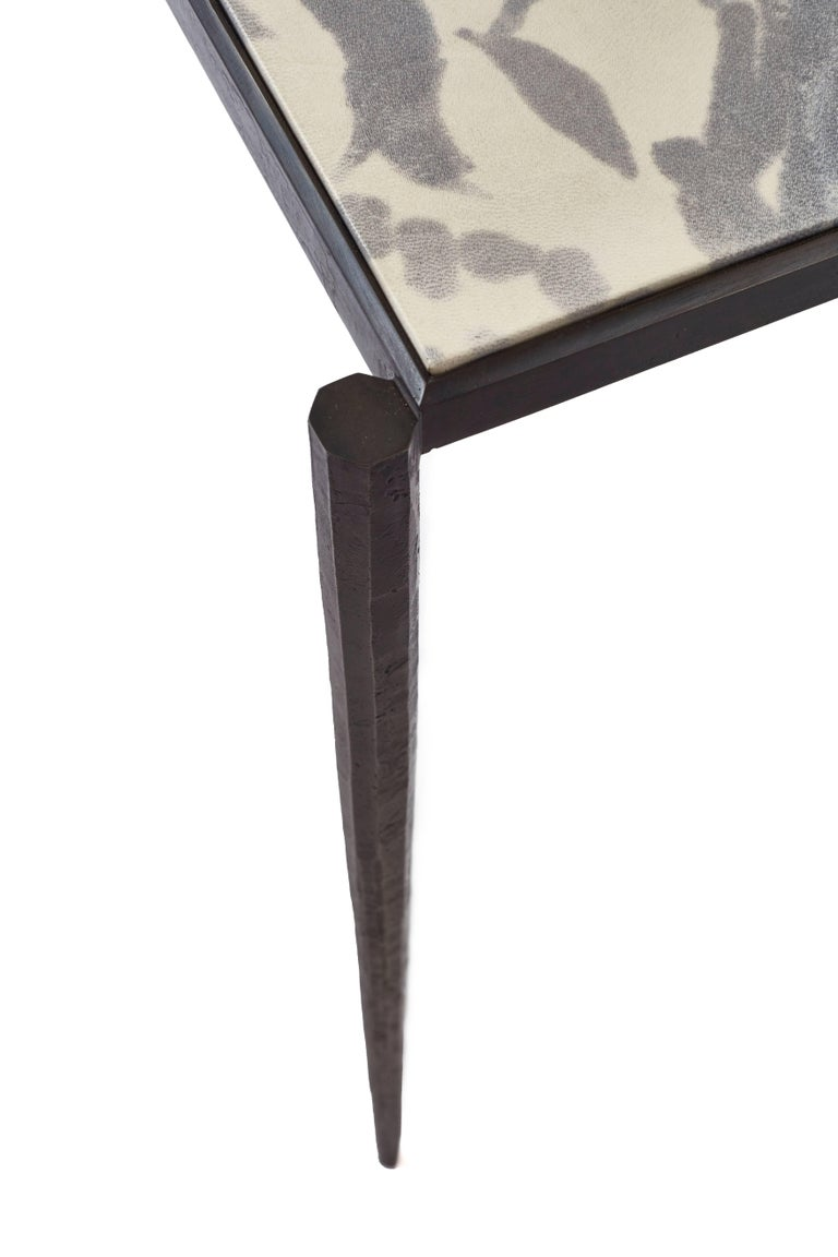 The sleek Shibori console table features hand-painted goatskin parchment, shown in indigo and bright rose, atop a forged steel frame. Featured in interior design magazine. We are always interested in material combinations and will gladly discuss