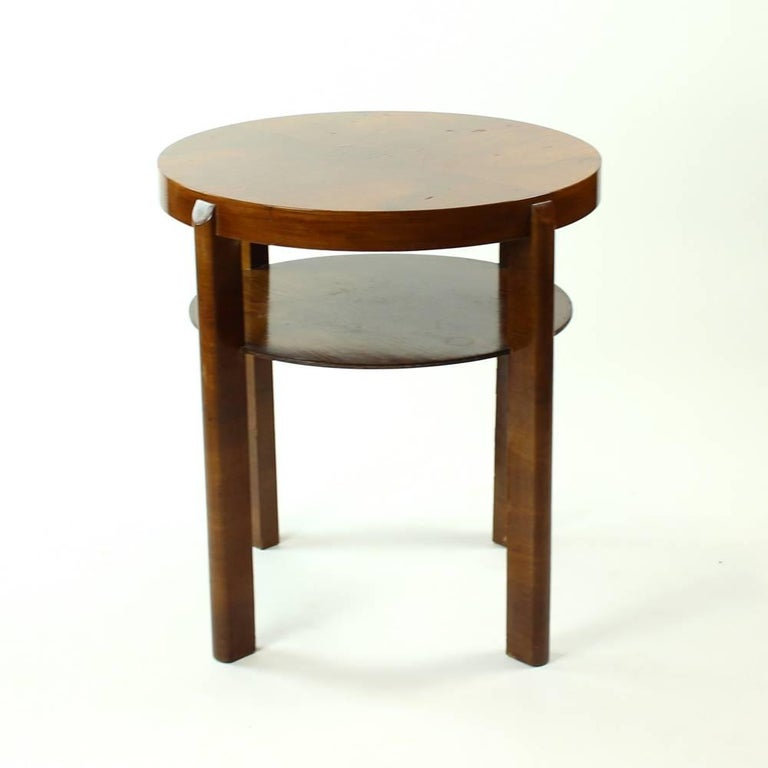 Classical tall round table side table by Jindrich Halabala. Produced in beautiful walnut veneer. Stands on four legs. Some patina and wear visible on the veneer on table and legs. Beautiful design and very elegant item.