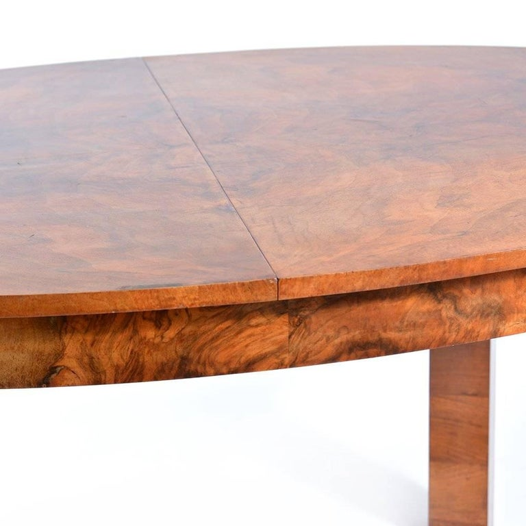 Large oval fold out Art Deco dining table in beautiful finish and lots of elegant details. Made of hard wood with beautiful walnut veneer finish. Table easily sits eight people. When folded out it is 229cm long. Beautiful, very good condition with