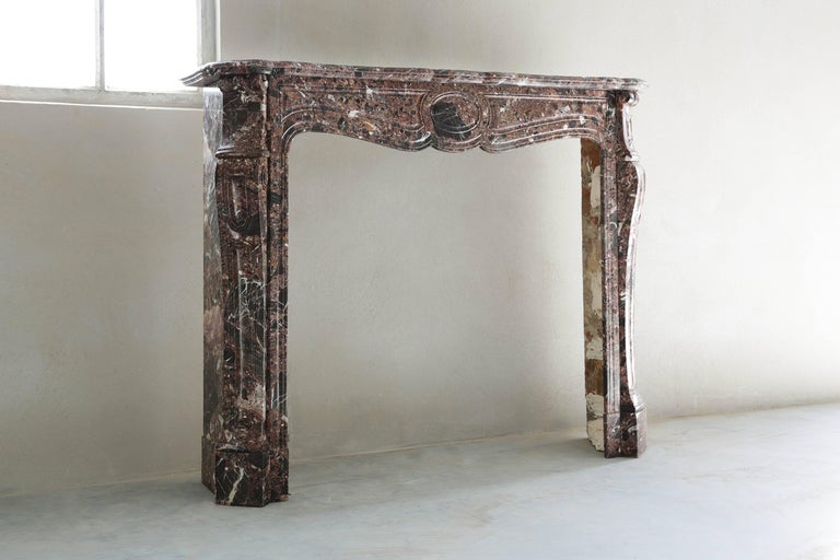 An elegant and nice marble fireplace in the style of Pompadour. We found this beautiful antique fireplace in Paris.