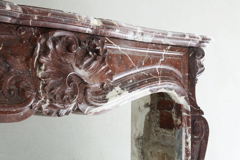 Very exclusive and unique antique marble fireplace. The kind of marble is Griotte Rouge de Belgique. Very warm and atmospheric appearance!