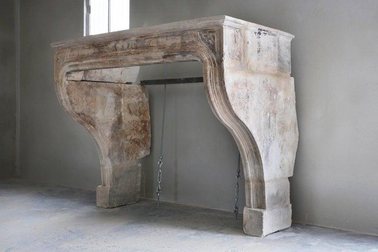 A very elegant and beautiful antique fireplace. Louis XIV Original retours. Perfect patina. Origin 18th Century from Paris - France