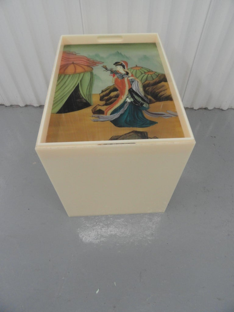 Custom acrylic table with removable top. The top contains an inserted piece of reverse glass painted art of an Asian female figure.