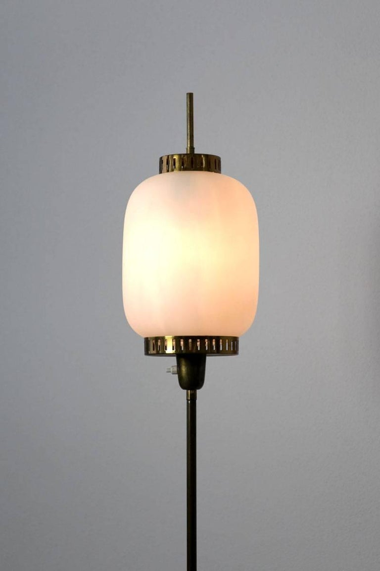 Italian floor lamp with opaline glass in the manner of Stilnovo, 1960s.