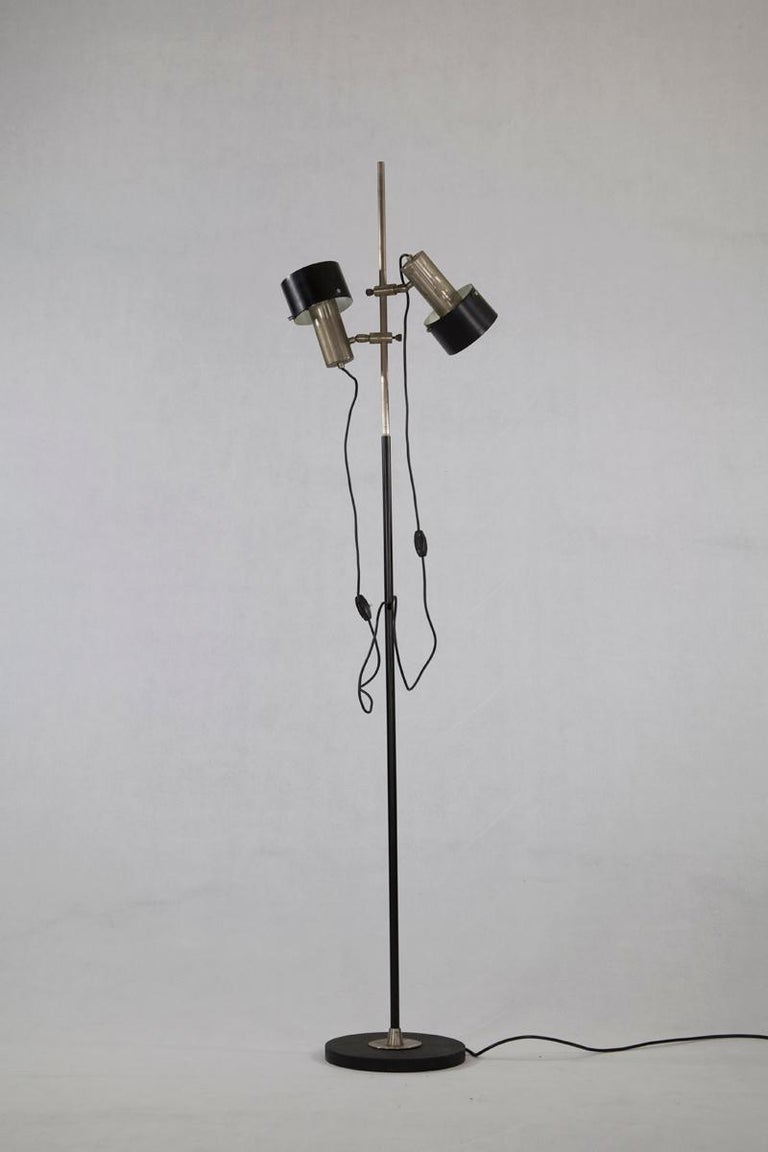 Floor lamp - design by Stilnovo, Italy, 1960s. The lamp is nickel-plated and has black lacquered Aluminium shades which are adjustable.