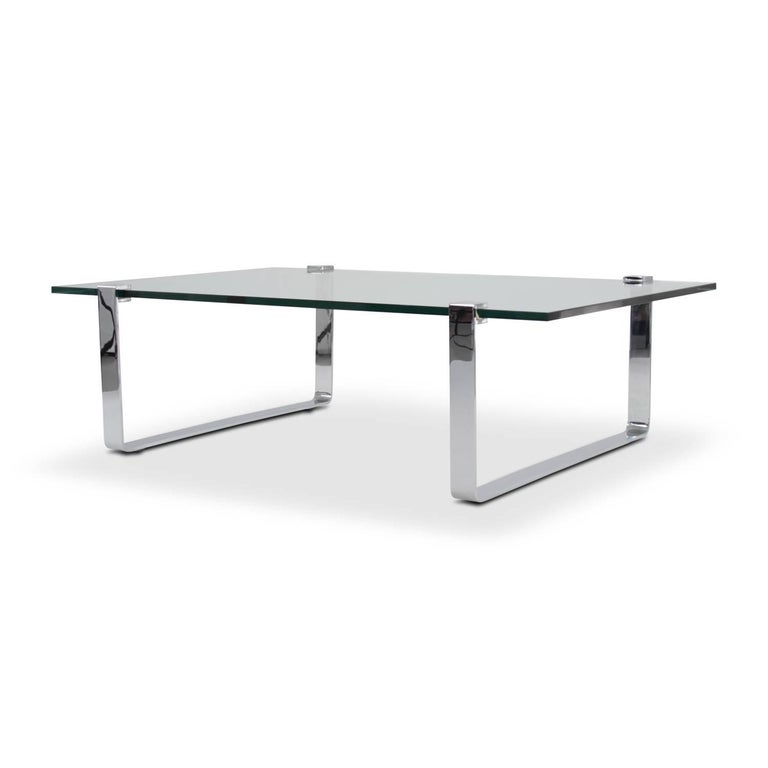 Rectangular Ronald Schmitt coffee table with a 19 mm glass top and runners in solid steel polished chrome. Modell K 831 by Friedrich Wilhelm Möller.  Feel free to contact us for more detailed pictures.