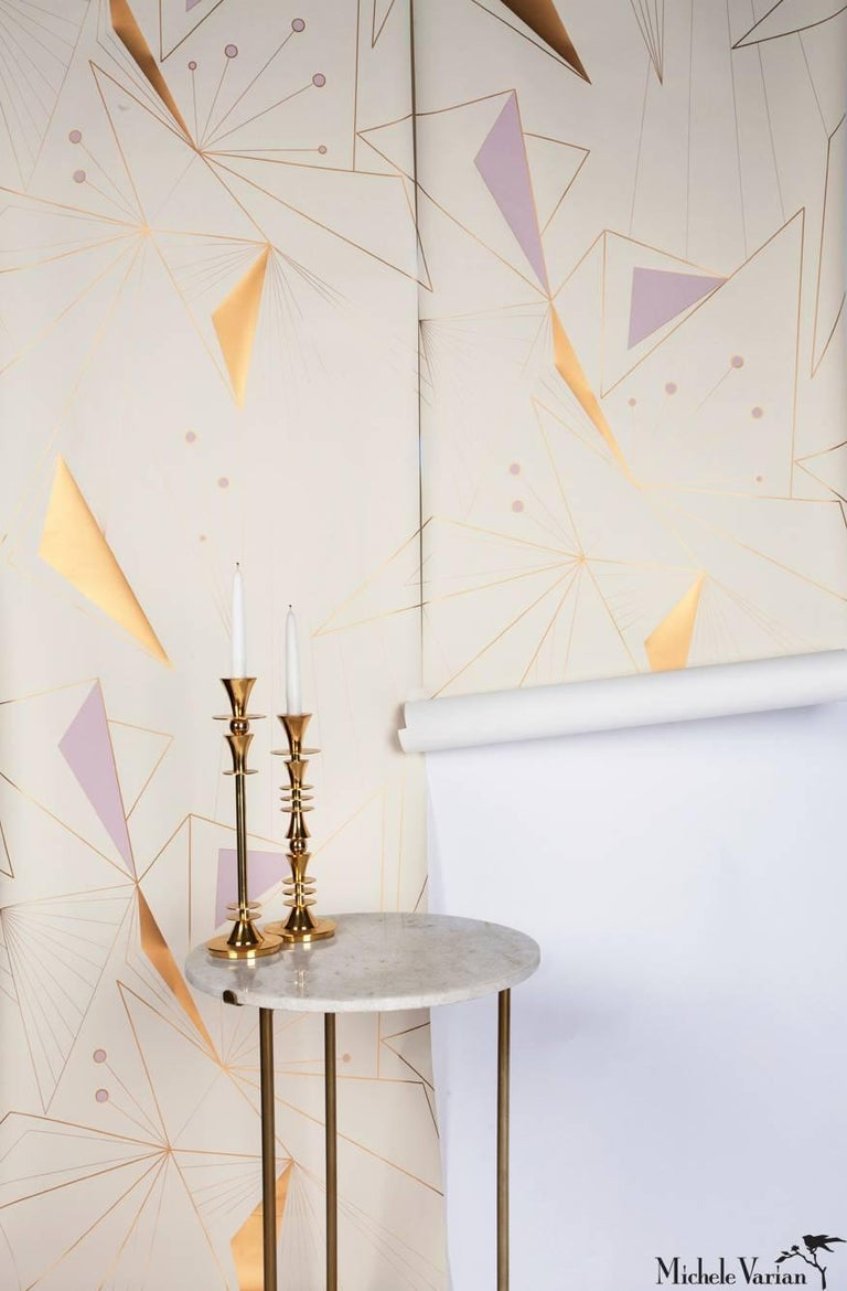 This modern, and geometric wallpaper adds graphic warmth and texture to your walls in a soft color palette of metallic bronze/gold, light lilac and off-white. It works well with Mid-Century Modern, Hollywood Regency, Art Deco and contemporary