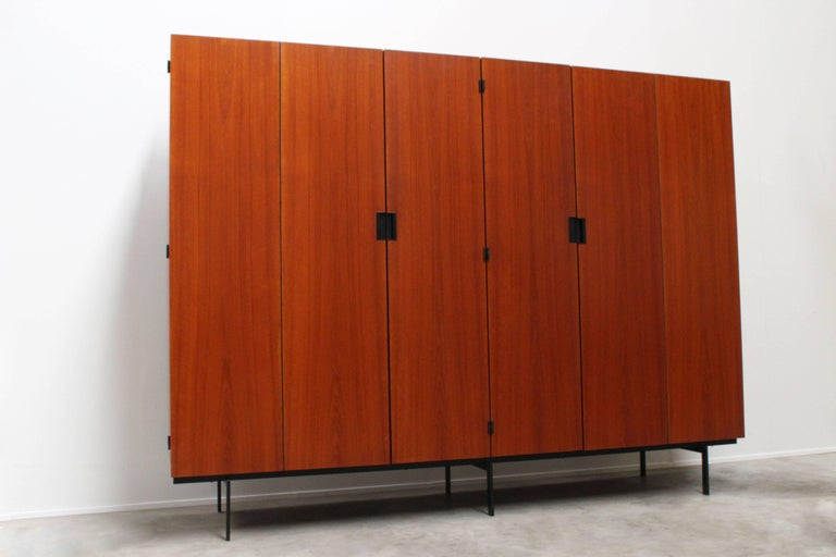 Large KU-16 Japanese series cabinet designed by Cees Braakman for Pastoe, 1958. Cees Braakman's Japanese series is known for its Minimalist look and warm teak colors. Cabinet interior with multiple shelves, mirror, sock storage, tie storage and