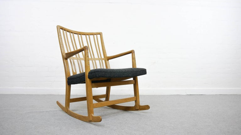 Rocking Chair by Hans J. Wegner, 1940. Manufactured by Mikael Laursen, Denmark. This is the first version of this rocker - produced only for a short time period- with floral carvings! Later models do not have this! Made from solid oakwood. Lit: