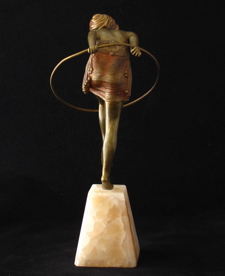 Art Deco bronze figure of a dancer with hoop. Gilt and cold painted with her arms outstretched behind her, stepping through a hoop. Signed Chiparus in the marble base. Approx height 25 cm. French c 1925 - Excellent original condition. A similar