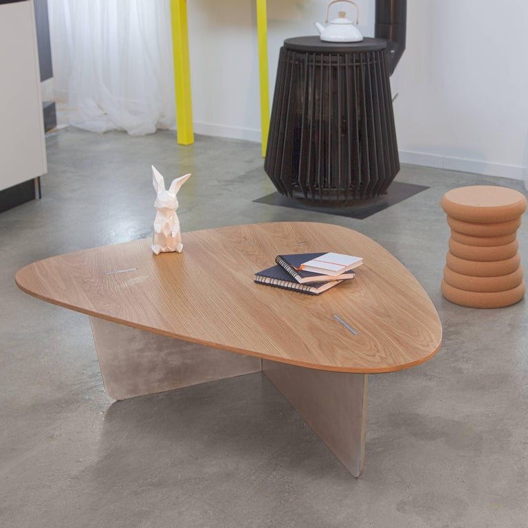 UFO alert! Aero is flying over your living room. Its laser cut metal leg, seems to slightly levitate over the floor. It comes perfectly on the surface of the wooden top for a combination of two kind of raw materials. Successful alliance between