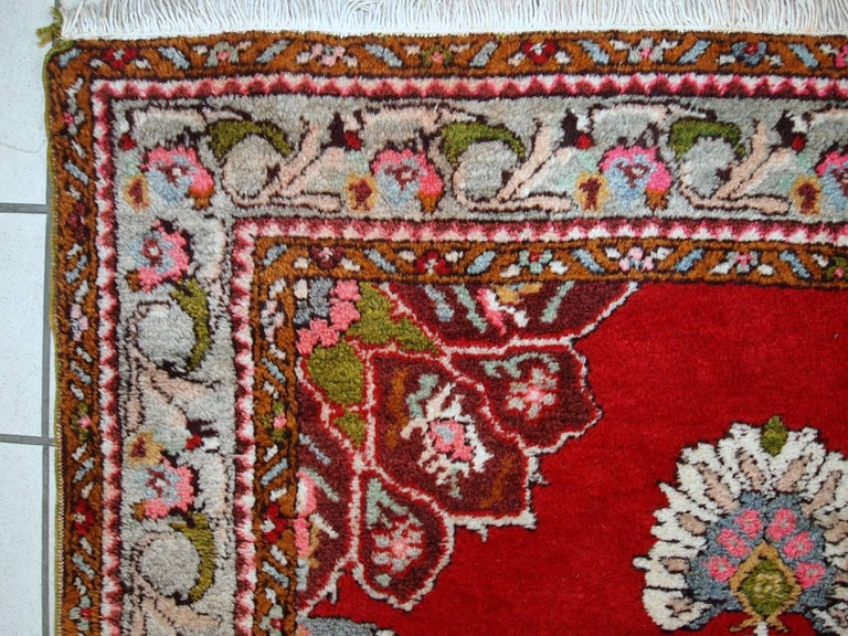 Vintage woollen Turkish Oushak runner in original good condition. It is in bright red shades with sky blue medallions. The wool is very soft which is typical for Oushak rugs.