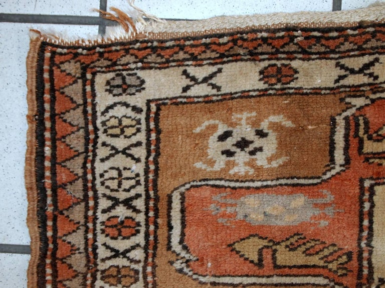Turkish Oushak runner from the mid-20th century in unusual tribal design. The rug is very narrow and made in soft wool. Design is very unusual and contains shades of: brown, peach, beige, burgundy. The runner is in original good condition, one