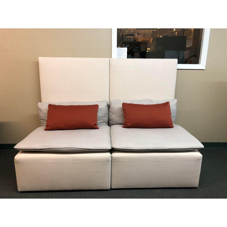 A Modern Modular Sofa Unique In Its High Back And Monotone Hues Ivory