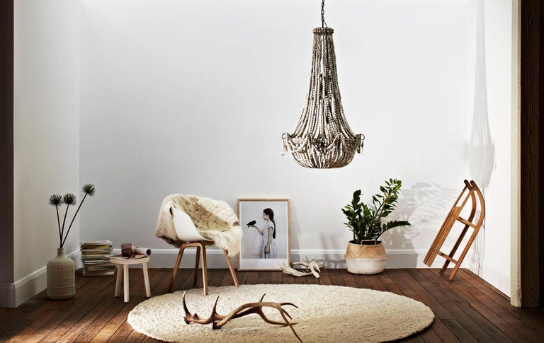 Long, lean and ever so lovely.  The elongated klaylife clay beaded chandelier is especially designed for tall, double volume spaces. Whether you have high ceilings or a large void like a stairwell that needs a statement pendant, this design mixes