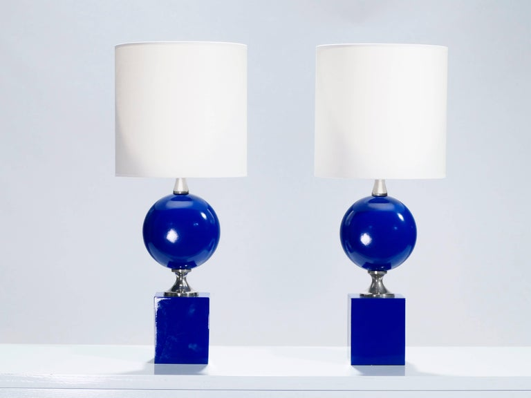 Electric blue is not a color you come across often in bedside lamps. This Mid-Century Modern pair was designed by French lighting artist Philippe Barbier in the 1970s and with its bulbous midsection topping a thick square base, is typical of his