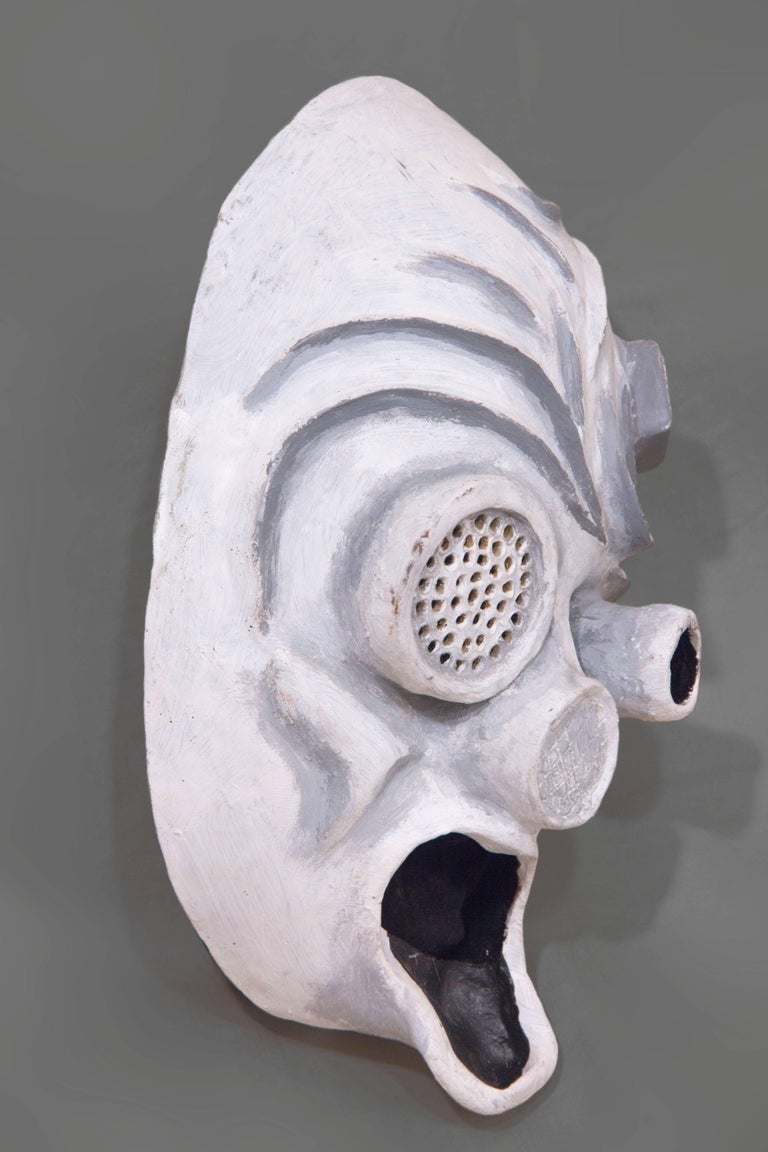 """Inspired by the Edvard Munch's painting """"The Scream"""", this mask was made for a theatrical production to portray brainwashed workers in a dystopian future. This piece is wearable art, making it perfect for a masquerade, costume party,"""
