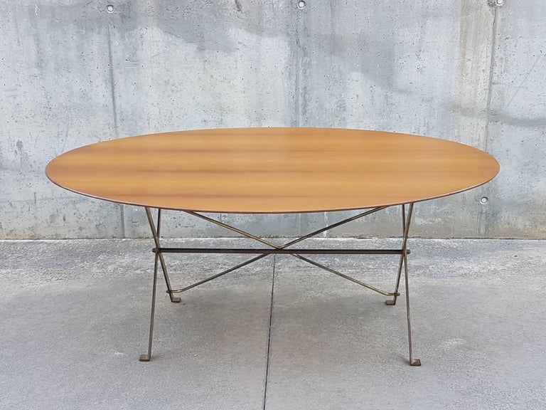 This rare and iconic table was designed by Caccia Dominioni in 1947 and produced by Azucena. It features a golden brass folding structure with an elegant and thin wooden tabletop. It remains in a very good vintage condition: Wear and patina due to