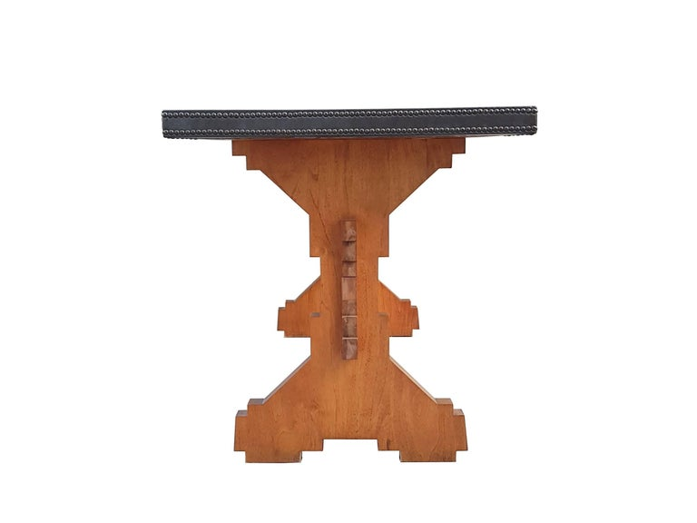 This rare midcentury table was produced in Italy around the 1950s. It is made from a singular wooden structure which revisits the traditional Italian