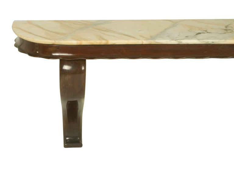 This fine console table was manufactured by Fratelli Barni Mobili d'Arte, a small manufacturer based in Seveso, near Milan, circa 1950s. It is made from laquered wood and a marble top and it is wall-mounted. It remains in an overall very good