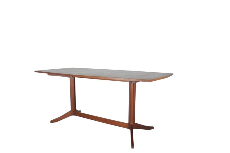 A beautiful rosewood table manufactured by Roberto Poggi and attributed to Franco Albini. It remains in a very good vintage condition: signs of wear and use as in pictures.
