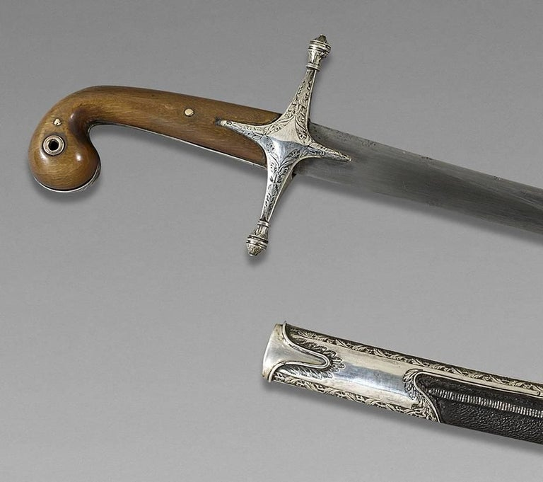 Oriental Saber, also called Shamshir Ottoman Empire, late 18th century  Handle in horn, silver mounted, damascus blade, scabbard garnished of black leather.  Measures: Whole saber: 40 1/2 wide  Blade: 40 1/2