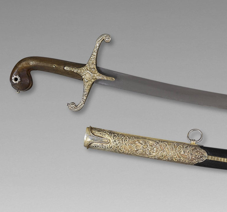Oriental saber, also called Killich Ottoman Empire, late 18th century  Handle in horn, silver mounted, Damascus blade, scabbard garnished of black leather.  Measure: Whole saber 40