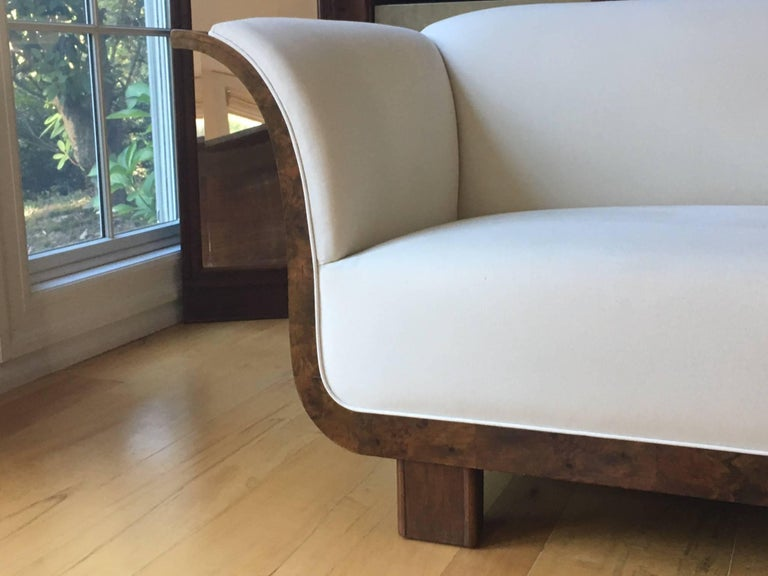 Stunning Danish Art Deco sofa. Burled and French walnut, circa 1930.  This beautifully designed sofa, with its fabulous curves, was originally meant for installation directly against a wall with an unfinished back. We wished to honor the original