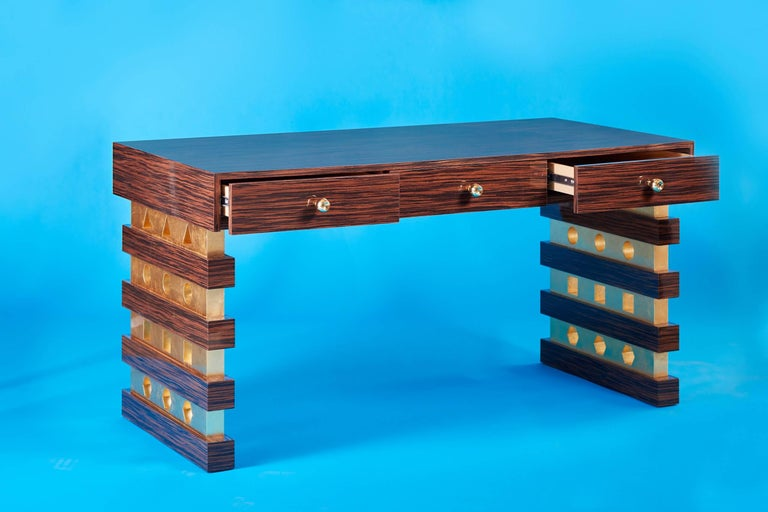 21st century custom handmade contemporary Macassar ebony, gold gilt and brass desk  Shape Shifter Desk This beautiful handcrafted Art Deco contemporary desk is a standout of size, proportion and materials. Brass knobs were individually crafted and