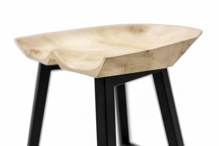 Modern tractor-seat style bar and counter stool. Shown in bleached soft maple with stainless steel legs (available in any powder-coated color) and brass kick plate. Available in 18