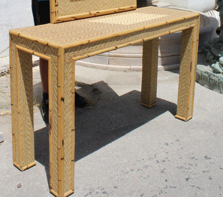 1980s bamboo and rattan console table with mirror set.   Mirror measurements: 105 x 73cm.