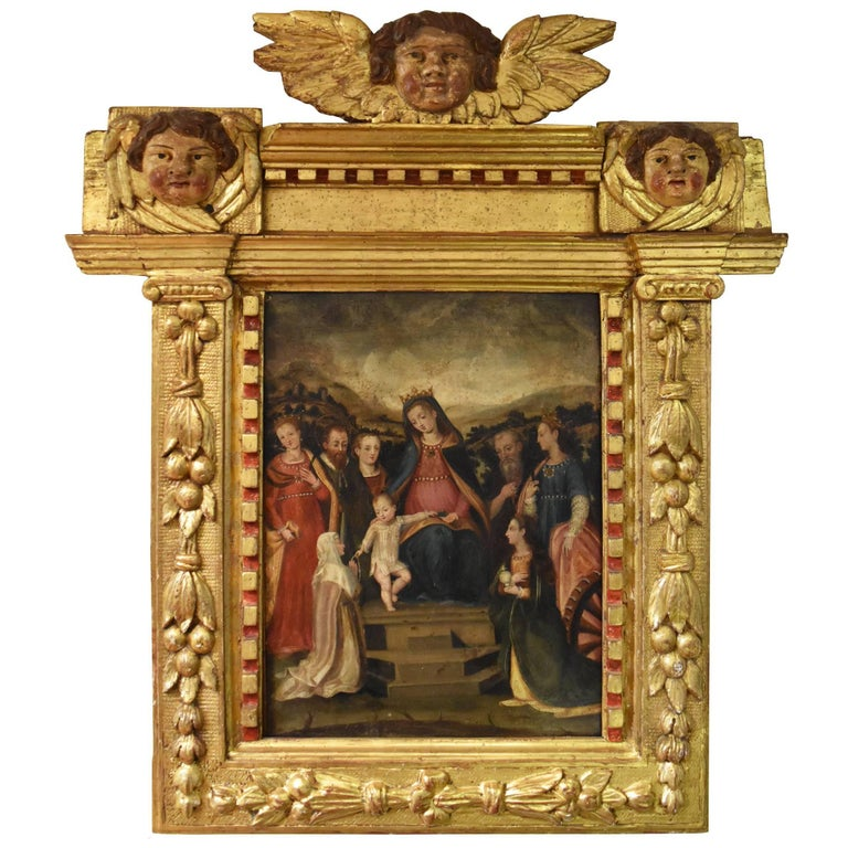 Spanish oil Colonial School S, 16th Century, Virgin with child and wood frame For Sale