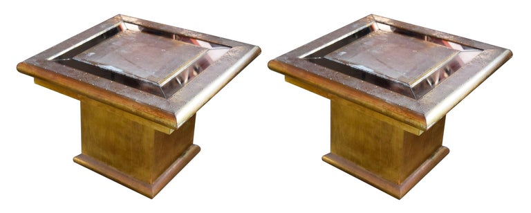 Handcrafted with fine brass sheets etched over a wooden frame and covered with smoked mirrors.   Rodolfo Dubarry arrived in the 1970s in Spain and worked tirelessly. His first special creation was the fireplace of the Menchú, the most exclusive