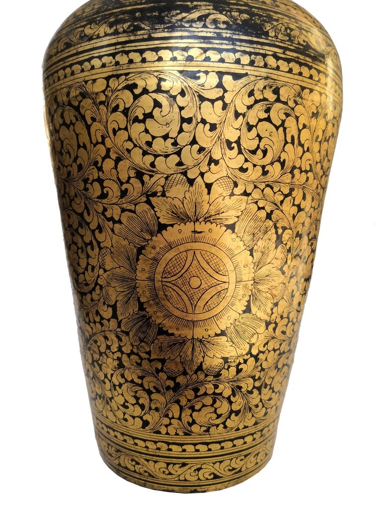 Unique Chinese black lacquered antique vase with detailed ornamental handmade decoration in 24-carat gold by specialized craftsmen.
