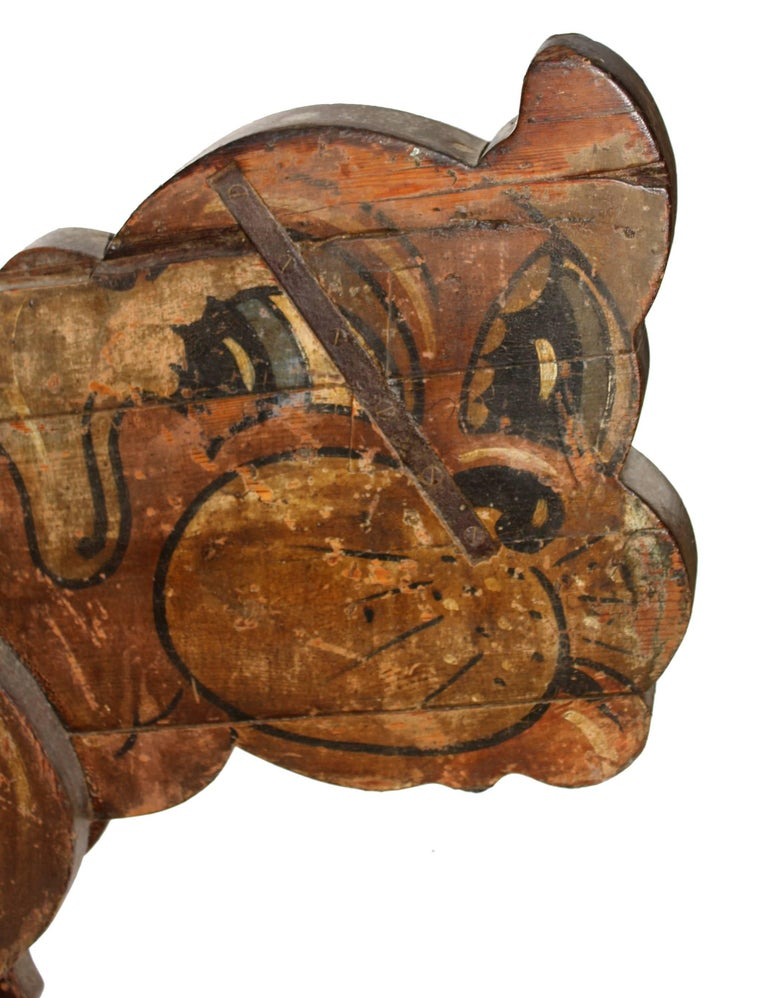 Spanish, vintage hand painted wooden dog with stuck out tongue, from an old fair ground Carousel.