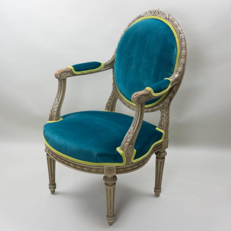 This pair of Louis XVI style armchairs have been recently updated in a lush blue-pine velvet and a coordinating lively lime velvet. These chairs were meant to make a statement. Now with the updated upholstery and the original design details, they