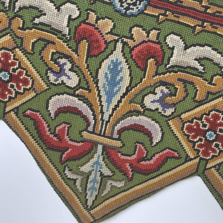 Beautiful fleur-de-lis needlepoint from the mid-1800s graces the front of the decorative cushion. The base of the pillow is a high quality velvet with down insert. This is perfect size for a settee, bench or a smaller sized sofa.