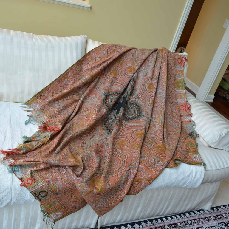 Earth tone, very large silk cashmere paisley throw shawl. We found this beautiful piece in a boutique just outside of Paris that specializes in wonderful finds from estate sales. It is believed to be from the mid to late 1800's and hand woven. It is