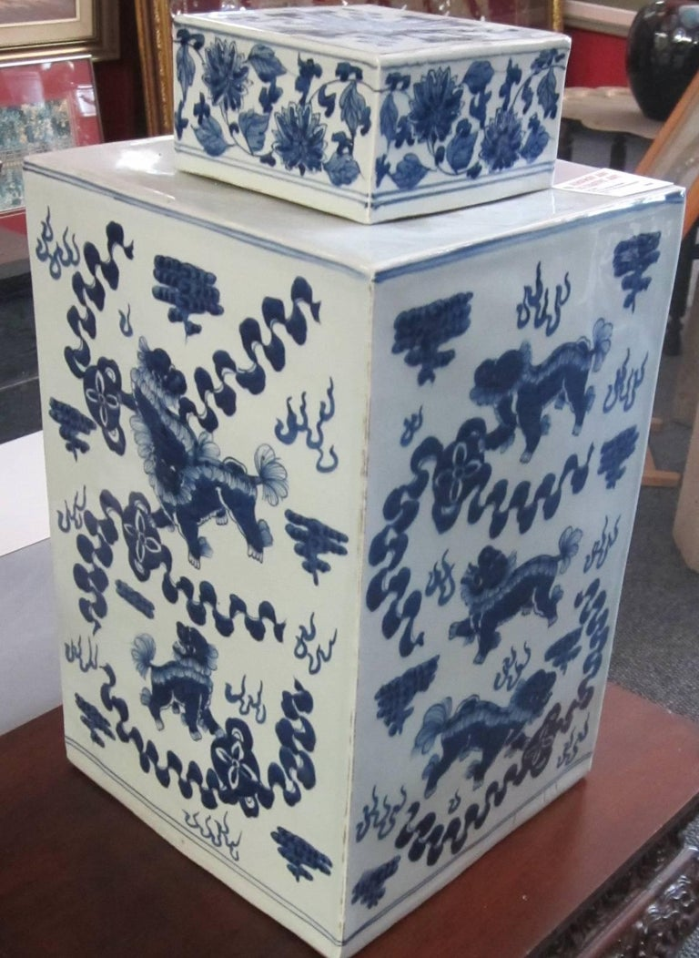 Blue and white lidded square Chinese ceramic urn,  no markings on base. This is a very unusual shape because of the difficulty of manufacture.