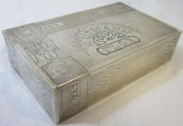 """""""Russian .875 trompe l'oel cigar box hallmarked 84 Zolotniks with woman's Kokoshnik within an oval cartouce and makers mark by Petrovich Khlebnikov, St Petersburg on the base and inside the gilt finished hinged lid. Engraved H. UPMAN/FLOR with a"""